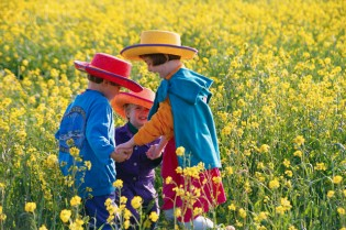 Children playing in field of flowers